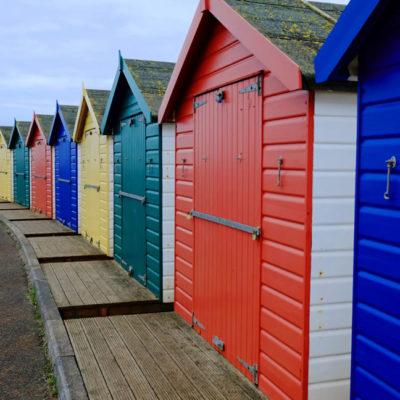 Multicoloured beachhuts on Dawlish Warren beach